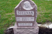 upright headstone with sculpted Holy Mary - erected in Watertown Massachusetts