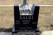 Sacred Heart of Jesus sculpted single headstone in Archdiocese Cemetery