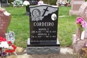 single grave Catholic headstone
