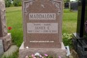 headstone with hummingbird
