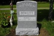 classic single headstone design on gray granite