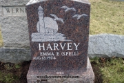 single headstone in Mahogany granite