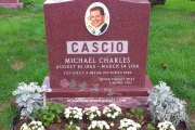 double monument with square raised family name and custom etched rose in color
