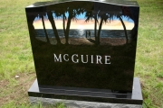 etched island scene on black granite - Forest Dale Cemetery, Malden, MA