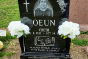 Hand etched portrait, etched roses and cross on single black memorial