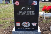 Sports themed headstone with Red Sox, Patriots logo,, Bingo card, racing horse and poker hand