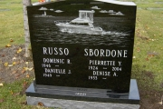 headstone with etched boat