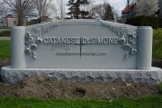 family headstone with raised lilies