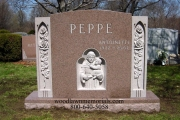 Sculpted St. Anthony and child headstone