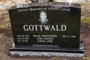 Black granite family lot monument with hand etched portrait - Wood End Cemetery, Reading, MA