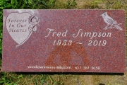 custom grave marker in Red Granite with heart, rose and bird