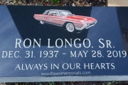 Black grave marker with hand etched car in color