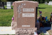 Single headstone with lilies