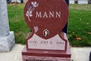 Red heart shaped headstone with photo