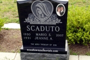 gravestone featuring Holy Mary in sandblast - Jet Black granite