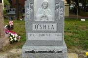 Sculpted single upright Barre Vermont gravestone design