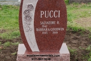 Single headstone with roses in Red granite