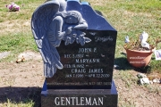 Single headstone with carved Angel