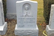 hand carved Blessed Mother on Barre Vermont granite - erected in Holy Cross Catholic Cemetery, Malden Massachusetts