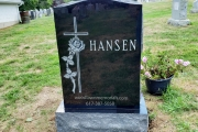 Single headstone for 2 people carved in black granite with cross and rose design