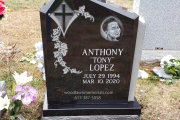 Single design in black granite with cross and etched portrait