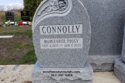 Single gravestone in Barre, Vermont granite with carved rose design