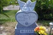 Dreaming angel headstone in grey granite