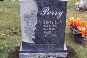 Bahama Blue granite with sculpted roses - erected in Wyoming Cemetery