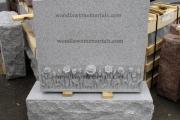 headstone with granite flowers