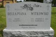 Barre granite unpolished headstone - two deep carved roses - two family names